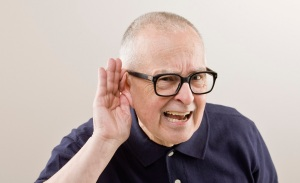 And older man cupping his ear to hear